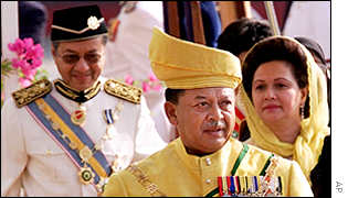 Malaysia's new King Tuanku Syed Sirajuddin, centre, is followed by his wife Fauziah Abdul Rashid, right, and Prime Minister Mahathir Mohamad