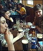 Young people drinking and smoking