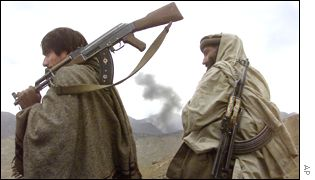 Anti-Taleban fighters watch US bombings near Tora Bora