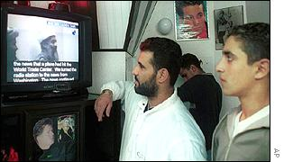 Men in a barber's shop in Sidon, Lebanon watch the Bin Laden tape