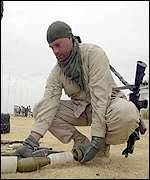 US Marine removing an unexploded mortar
