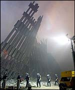 Fire-fighters in the shadow of the World Trade Center's wreckage in New York