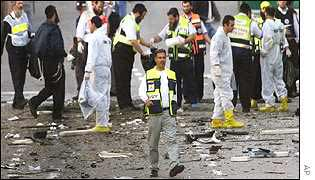Israeli officials investigate the scene of a suicide bombing