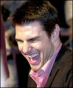 Tom Cruise laughing with fans at the Taipei premiere of Vanilla Sky