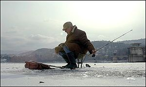 A local man fishes on the ice of the frozen Pancharevo lake outside Sofia in Bulgaria