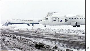 An Olympic Aviation and an Alitalia airplane are stuck in the snow at the airport in the northern port of Thessaloniki