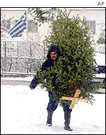 Man with Christmas tree in Thessaloniki