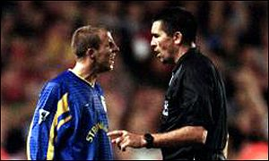 Leeds midfielder Lee Bowyer confronts referee Jeff Winter about his red card
