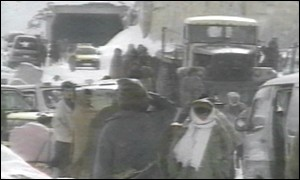 People and vehicles outside Salang tunnel