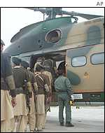 Pakistani soldiers board a helicopter to patrol the border area with Afghanistan