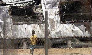 Burned out building at Woomera detention centre in southern Australia, December 2001