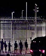 Police at the Woomera detention centre of immigrants in southern Australia