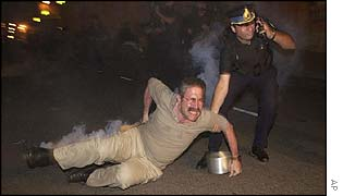 Policeman drags protester
