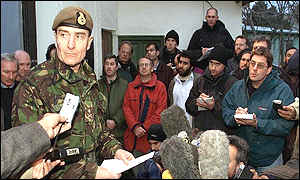 Major General McColl speaks to journalists outside the British embassy in Kabul