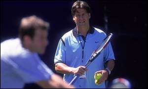 Greg Rusedski is watched by Sven Groeneveld during practice in 1999