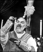 Padre Pio celebrating mass
