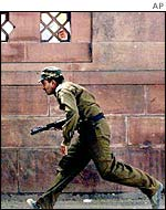 Indian soldier runs for cover during parliament attack