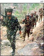 Indian soldiers patrol the Line of Control
