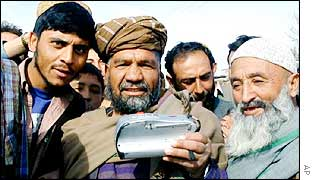 Afghan men with a radio