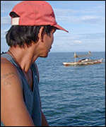 Subsistence fisherman  heads for sea in the waters off Bohol island