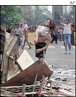 Protester throwing a stone in Buenos  Aires