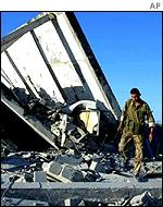 December: A Palestinian policeman inspects the damage done by Israeli air strikes