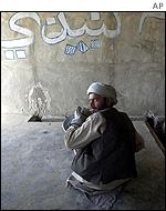 An Afghan man cleaning one of Afghanistan's public baths