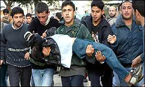 Palestinian protesters evacuate an injured boy
