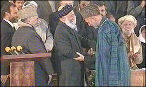 Hamid Karzai (right) and outgoing President Burhanuddin Rabbani