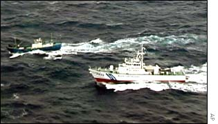 Japanese coast guard boat chasing the unidentified boat in the East China Sea