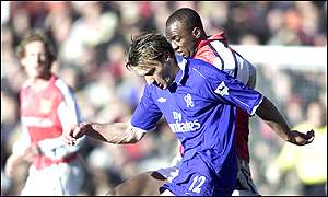 Stanic battles with Arsenal's Vieira