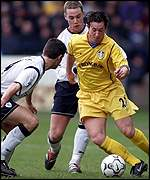 Robbie Fowler takes the ball pass Bolton's Anthony Barness and Kevin Nolan