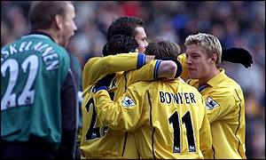Mark Viduka, Lee Bowyer and Alan Smith embrace Robbie Fowler