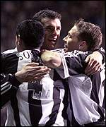 Newcastle's Gary Speed is congratulated by Nolberto Solano and Craig Bellamy
