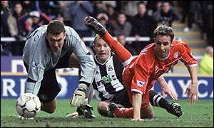 Alan Shearer gets the better of Middlesbrough's Mark Crossley and Gareth Southgate