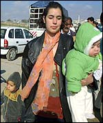 Mother and children at Kalandia checkpoint
