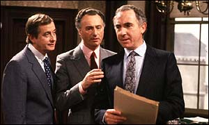 Derek Fowlds as Bernard Woolley, Paul Eddington as Jim Hacker and Sir Nigel Hawthorne as Sir Humphrey Appleby