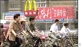 A cyclist rides past a McDonald's in Beijing