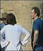 Tony and Cherie Blair listen to a guide