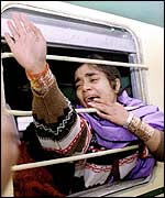 A Pakistani woman bids farewell on the train to Delhi