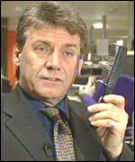 Sunday People editor Neil Wallis displays an innocent looking comb