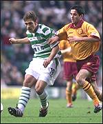 Keith Lasley chases Celtic's Stilian Petrov