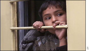 An Indian boy looks out as the train leaves Lahore station