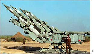 An Indian soldier guards missiles near the country's border with Pakistan