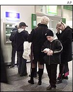 Lining up for euros at an ATM machine in Brussels