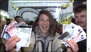 Excited woman waves her new euros