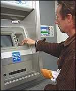 A cash machine dispensing francs