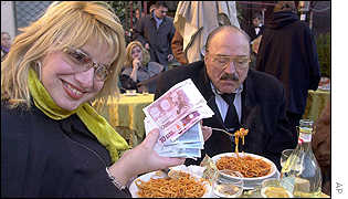 Martine Julliard from Lyon paying for spaghetti in euros