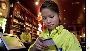 Waitress checking her euro converter