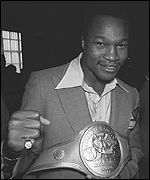 Larry Holmes with the WBC belt